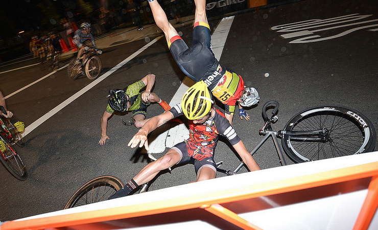 Guy was caught using aero bars, so the crane came out and grabbed him by his ankle. Crazy.  Source: bklynjosh